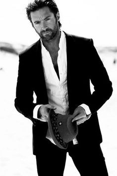 Hugh Jackman Photoshoot - I love the whole look - the suit, shirt, hat, his awesome hair and beard.