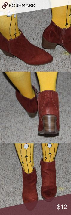 """Rust Colored Booties Rust colored ankle booties.  Easy slip on design.  Padded foot bed for comfort.  Zip enclosure on inner side of boot.  Heel measures about 3"""".  Shoe box included. Shoes Ankle Boots & Booties"""
