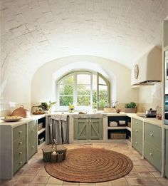 I know this is a kitchen but thinking a vaulted / curved ceiling may look pretty funk in the bathroom?... Hmmmmm High ceiling as it is, may make it feel a bit more cosy...