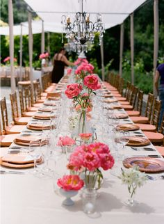 not necessarily with these flowers, but this is the look of varying height centerpieces, for the long tables