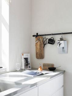 Kitchen details. White IKEA Voxtorp cabinets, Silestone worktop