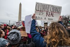 Protesters hold signs supporting climate science at Trump's inauguration
