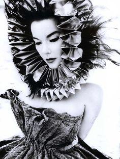 Björk photographed by Inez van Lamsweerde & Vinoodh Matadin  in Louis Vuitton & Paper headdress & necklace by Bea Szenfeld