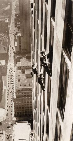 Window cleaners on the facade of a skyscraper. United States, 1941 & safer then, even without OSHA...