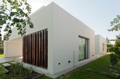 wooden louvres Casa MC / VismaraCorsi Arquitectos