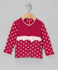 Beetroot Purple Polka Dot Cardigan. Rosie the Riveter could easily wear this after work.