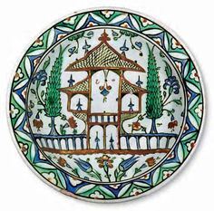 Dish with a representation of a garden / Turkey, Iznik, circa 1575 –1580 / Fritware, polychrome underglaze painted on an opaque white glaze, Ø 29.8 cm / Kindly lent by Princess Catherine Aga Khan