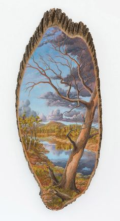 """Alison Moritsugu uses remains of downed trees as canvases for her bucolic oil paintings of the countryside where she imagines that particular part of the tree to have come from. History and themes of environmentalism are brought together in a visually appealing package.  Moritsugu writes in her artist statement, """"By exploring idealized views of nature, my work acknowledges our more complex and precarious relationship with the environment."""""""
