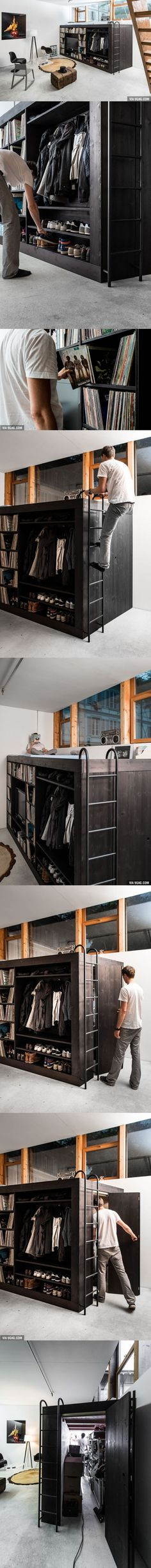 "This guy built this amazing ""Living Cube"" - shelved, bed, and an enclosed closet area."