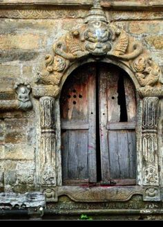 amazing..wonder what these doors would tell us if they could speak.  They look very old