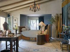 ~A leather Napoleonic bed takes center stage in the theatrical, but completely livable Santa Barbara bedroom of designer John Saladino.