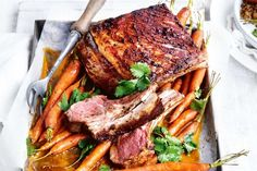 Serve up a feast with this succulent roast lamb served with golden roast carrots and quinoa pilaf.