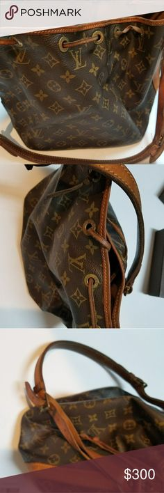 Vintage Louis VUITTON  Noe Bag Louis VUITTON  bucket bag. It is probably 20+ years old , used but still a classic bag. Brown leather has aged beautifully . Please see photos for condition . I have posted a picture of code but it is not easy to see. Will try to clean ink  but slow process. Louis Vuitton Bags Shoulder Bags