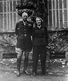 With General Patton. She became his lover and he gave her a set of pistols to use in case the Nazis captured her. He also helped her locate her family in Germany after the war ended.