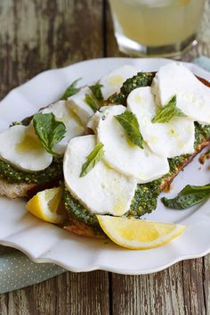 Bruschetta with Basil Pesto, Mozzarella & Lemon: Serves 2    4 slices sourdough bread, drizzled with olive oil, grilled and then rubbed with half a garlic clove  3 tbsp MD Basil Pesto (thinned out with 2-4tbsp olive oil)  150g (5.29 ounces) Fior Di Latte/Mozzarella  juice of 1 lemon  olive oil for drizzling  salt & pepper to taste  fresh basil leaves, to serve