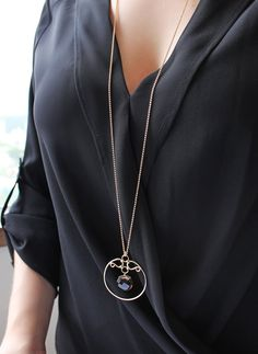 """This elegant necklace is a show-stopper!   It is made with 14 Karat Gold Fill and has a dramatic length of 38"""". The filigree pendant measures at approximately 2"""" in length and 1.75"""" in width. The gemstone is a beautiful faceted Smokey Quartz coin."""
