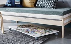 "The side view of a puzzle board on wheels under a sofa - how to store an ""in progress"" puzzle, a diy project from Ikea. Puzzle Storage, Ikea Storage, Under Bed, Diy Table, Ikea Hacks, Apartment Living, Home And Living, Living Room, Living Spaces"