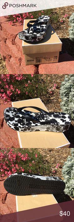 MK Bedford flip flops MK Bedford wedge flip flops, black and white, size 7, NWOT. Michael Kors Shoes Sandals
