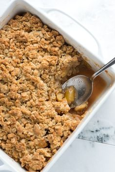 This apple crisp recipe with oats has sweet tender apples and a crisp and crunchy topping made with flour, oats, brown sugar, butter and cinnamon. Recipe on inspiredtaste.net | @inspiredtaste