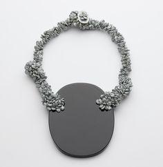 Iris Bodemer-(DE)  ngredients_Neckpiece 2008  Obsidian, zinc, fishing line  17 x 26 x 2,5 cm_Archive No. 08-001