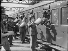 Tea being served to evacuated troops in a train at Addison Road station, London, 31 May 1940.