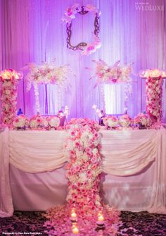 Gorgeous pink and white wedding reception decor.  Luxe head table