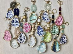 Decoupaged oyster keychainsListing is for one keychain ** If an option that is shown in the pictures in not shown in the drop down menu it means it is currently sold out and we are working to restock! ** Oyster Shell Crafts, Oyster Shells, Sea Shells, Koi, Seashell Crafts, Seashell Jewelry, Beach Crafts, Fun Crafts, Beaded Jewelry