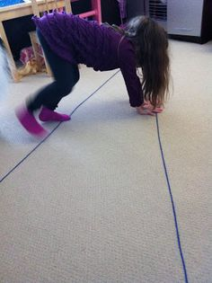 Using both the upper extremity and lower extremity in order to move the body from one side of the two lines to the other