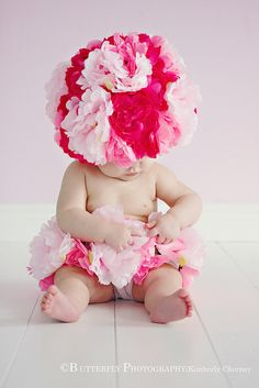 Kimberly Chomey photography - It's like an adorable, colorful lil afro puff...LOVE it!