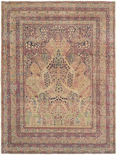 With a magical glow enhanced by the passage of approximately 175 years, this precious antique Persian Laver Kiman carpet's incredibly wide ranging color palette creates a sublime atmosphere that is truly seldom found, even among other very early Persian carpets.