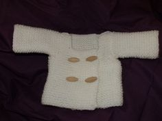 Wondering how to knit a baby sweater? Learn how using this double-breasted, toggle sweater pattern with very basic instructions for a garter stitch.