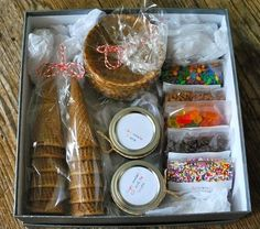 Ice Cream Sundae Kit; Include waffle cones, waffle bowls, jars of caramel and chocolate sauce, tiny bags of chocolate chips, nuts, and loads of sprinkles.