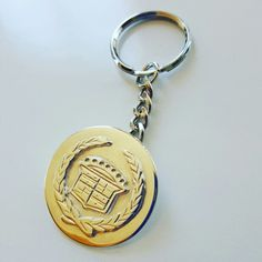 1970s Cadillac Logo Key ring in solid brass or sterling silver.  Made by Karen Ryder.  Raised design of the wreath and central design.