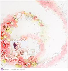 "And Jaya's layout is a partial wreath, again adapting the theme to fit her style! Gorgeous! ""For today's theme I made this layout with a wreath-like background. This page is inspired by one of Prima's older BAP sketches that I absolutely loved! I used watercolor confections and Oil Pastel Crayons for my background and created the wreath with tons of gorgeous Prima Flowers! I also colored a few flowers to match the color palette. I love how this one turned out."" ~ Jaya"