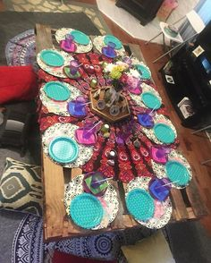 The table I made for my sisters bachelorette party. I just put two same size pallets together with screws, to secure them. And laid it on to my fold down futon. So it would be raised off the floor. Laid rugs pillows and blankets under it. And a mandala blanket over the pallet board. Then just decorated with various bohemian decor and place settings. I loved how it turned out and it was so easy to put together. #diy #hippie #boho #bohemian #bacheloretteparty #table #party #doityourself