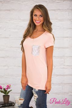 We are in love with this beautifully soft blouse! Featuring a gorgeous blush pink material, this blouse will make you feel like you're wearing your favorite vintage tee all day long!