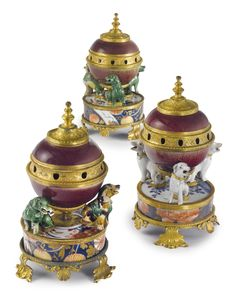 An ASSEMBLED SET OF THREE LOUIS XV ORMOLU-MOUNTED CHINESE AND JAPANESE PORCELAIN 'POT-POURRI' VASES,circa 1735, the porcelain 18th century