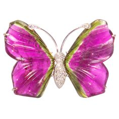 A Beautiful Unique Hand Made Butterfly Brooch Pin with Hand Carved Watermelon Tourmaline Wings; Diamond Pave antennae and body; mounted in 14K White Gold...