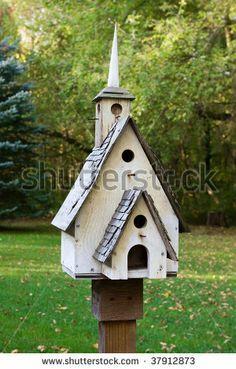 homemade bird houses | Home made wooden bird house on a pole. - stock photo