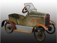 "Pressed Steel Gendron Roadster Pedal Car Toy. Description Circa 1929. Original painted body with some replacement parts. Size 42"" L."