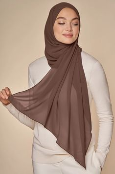 The fabric that started it all. Our signature chiffon is light, crisp and easy to care for, giving you a sleek, polished look every time. It features a rich cocoa brown hue with a hint of pink undertone you'll reach for again and again. Hijab Outfit, Girl Hijab, Modern Hijab Fashion, Street Hijab Fashion, Fashion Outfits, 70s Women Fashion, Muslim Women Fashion, Celebrities Fashion, Stylish Hijab