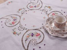 Cotton cross stitch embroidery with Crochet Lace table topper