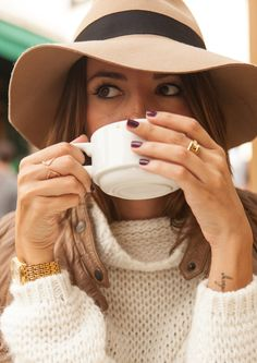 Perfection. Floppy hat, loosely woven turtleneck, deep merlot nails and a caramel jacket. And a warm latté of course