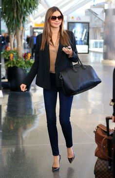 Miranda Kerr departs NYC via JFK Airport in NYC.