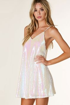 Sleeveless V-neck cami dress with iridescent sequin exterior. Full lining with multi strap design that criss crosses in back.