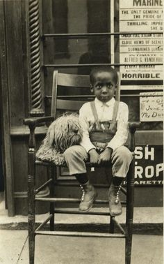 Vintage photograph of a little boy and his dog.