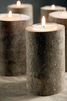 center pieces.  Recycle dead trees and limbs to cut small holes for tea lights! LOVE!