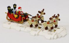 I decided I needed to get creative with Santa's sleigh and reindeer from the Santa's Workshop LEGO set I built a motorized base that tranforms it fr. Lego Christmas Ornaments, Lego Christmas Village, Lego Winter Village, Christmas Villages, Christmas Ideas, Lego Mindstorms, Lego Technic, Lego Duplo, Lego Moc