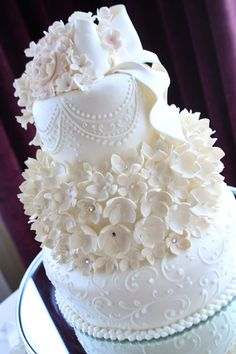 My wedding cake made by Lourdes Padilla♥ the bottom tier was pound cake, second was marble cake and the top was chocolate