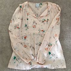 Anthropologie blouse Beautiful floral print. Worn one time. Has tiny mark that blends with the pattern. Anthropologie Tops Blouses